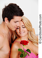 couple in bed with rose. proposal of marriage
