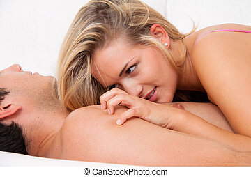 Couple in bed with sex and affection. Love and eroticism in...