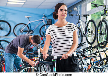 Couple in bike shop buying bicycle