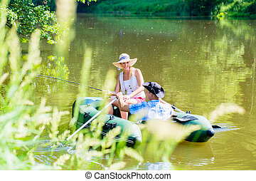 Couple in boat on pond or lake fishing