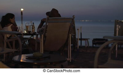 Couple in cafe by the sea