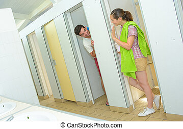 couple in camping bathroom