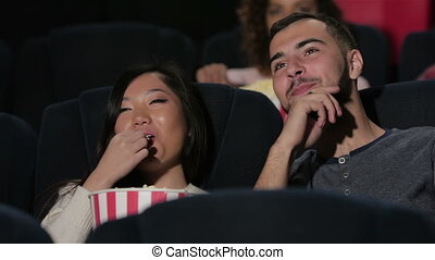 Couple in cinema watching a movie