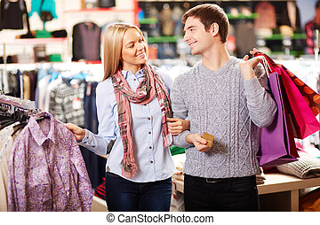 Couple in clothes department