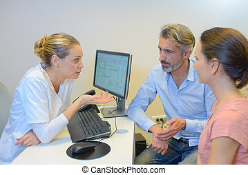 Couple in consultation with young female medic