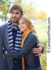 Couple in demi season clothes