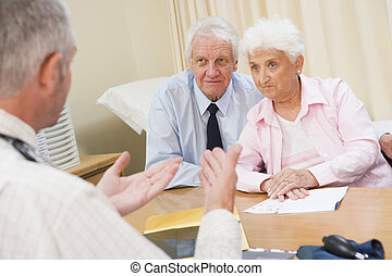 Couple in doctor\'s office frowning