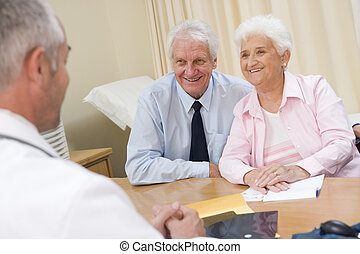 Couple in doctor\'s office smiling