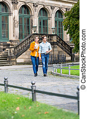 Couple in Dresden at Zwinger with coffee