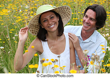 Couple in field of flowers