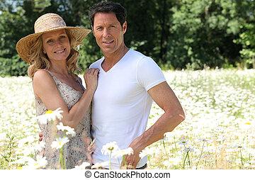 Couple in field of flowers.