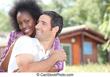 Couple in front of chalet