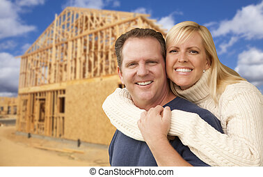 Couple in Front of New Home Construction Framing Site -...