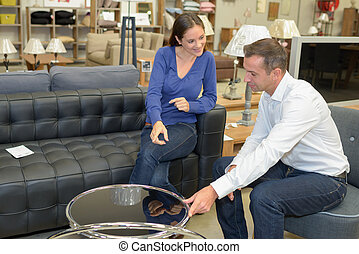 Couple in furniture store