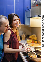 couple in home cooking kitchen