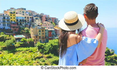 Couple in honeymoon with view of the old coastal town in Cinque Terre national park, Liguria, Italy ,Europe