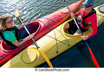 Couple in kayak on the river
