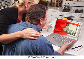 Couple In Kitchen Using Laptop - Money