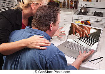 Couple In Kitchen Using Laptop - Music Performance