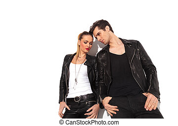 couple in leather clothes standing next to each other