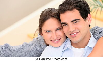 Couple in love are smiling at the camera