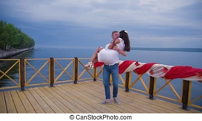 couple in love at the pier