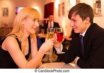 Couple in love enjoying drinks