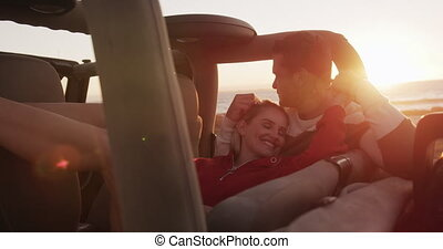 Couple in love enjoying free time on road trip together - ...