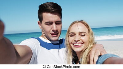 Couple in love enjoying free time on the beach together - ...