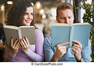 Couple in love flirting while studying