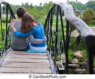 Couple in love - Happy couple is sitting and embracing on ...