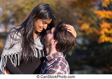 Couple in love hugging and kissing outside