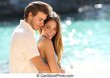 Couple in love hugging on a tropical beach