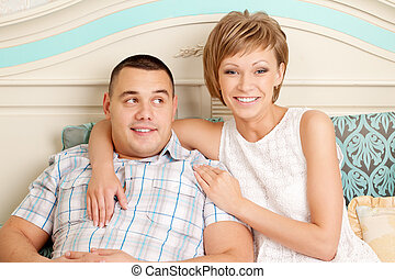 Couple in love hugs at home
