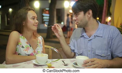 couple in love in an outdoor cafe. Man and beautiful woman on a date