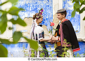 Couple in love in national folk costumes - Love couple...