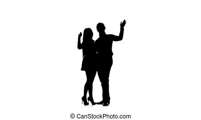 Couple in love is waiting for friends and waving at them. Silhouette. White background. Slow motion