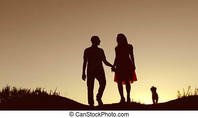 Couple in love kiss walking on sunset silhouette nature slow...