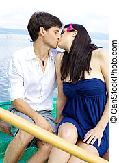 Couple in love kissing on a boat
