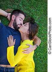 couple in love kissing on grass