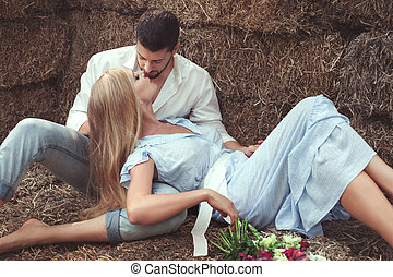 Couple in love kissing. - Loving couple kissing in the hay...