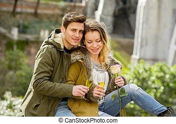 couple in love kissing tenderly on street celebrating...