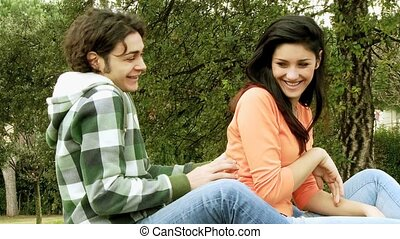 Couple in love laughing and playing