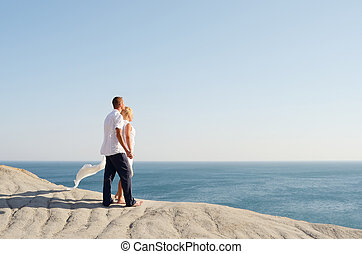 Couple in love looking at the sea