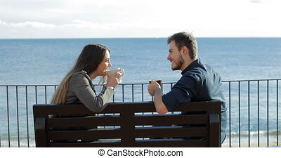 Couple in love looking each other drinking coffee