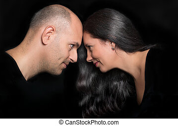 Couple in love looking to each other in profile