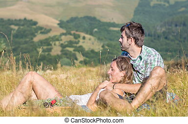 Couple in love lying on a picnic