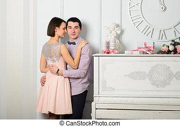 Couple in love near the piano