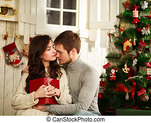 Couple in love on a background of Christmas decorations