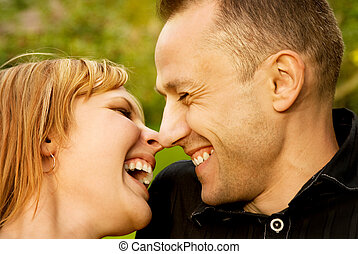 Couple in love outdoors. Close-up portrait.